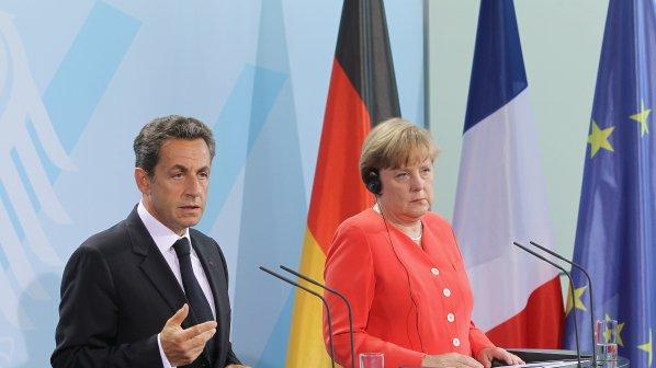 Меркел и Саркози се споразумяха за гръцкия спасителем заем