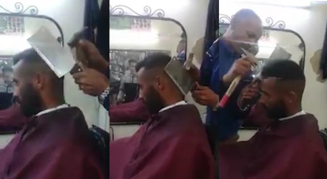 Бръснар стриже клиент с чук и сатър (видео)