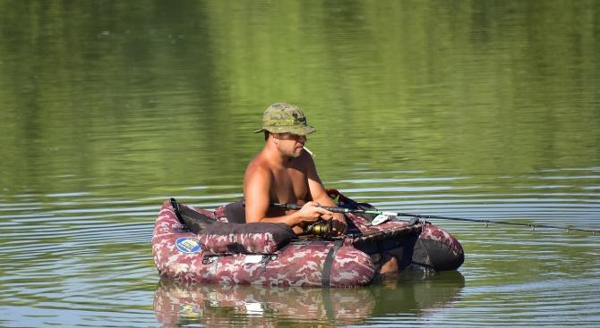 Мъж от Тексас улови риба с увита около нея гигантска змия